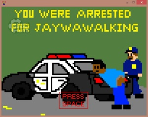 """In pixelated style, a nonwhite man in a blue shirt and pants leans over the trunk of a police cruiser with a white officer with a mustache standing over him. Across the top, in yellow lettering, """"You have been arrested for jaywawalking"""" [sic]."""